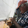 "Ben ""Biff"" Martin of Marblehead examines his model yacht following a race at Redd's Pond in Marblehead. Model Yacht racing has been gong on at Redd's Pond for years. Many people used the Marblehead Class boats, which are now imitated internationally. About 10 years ago, John Snow of Marblehead brought back the old Marblehead Class out of retirement and now many people race those, called ""Vintage Marbleheads."" Photo by Deborah Parker June 13, 2009"