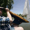 "Ben ""Biff"" Martin examines his model yacht following a race at Redd's Pond in Marblehead. Model Yacht racing has been gong on at Redd's Pond for years. Many people used the Marblehead Class boats, which are now imitated internationally. About 10 years ago, John Snow of Marblehead brought back the old Marblehead Class out of retirement and now many people race those, called ""Vintage Marbleheads."" Photo by Deborah Parker June 13, 2009"