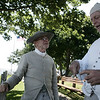 Reenactors Bill Buttimer, left of Beverly and Jim Witham of Essex rest in between battles at Fort Sewall as part of Glovers Regiment encampment. The event included two battles for the Fort against the British along with camp tours and demonstrations. Photo by Deborah Parker/July 11, 2009