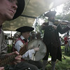 From left, reenactors, Matthew Brench and Joanna Brench, both of Stowe, Massachusetts along with Abijah Toddy of Leominster, entertain the crowd and reenactors during Glovers Regiment Encampment at Fort Sewall. Photo by Deborah Parker/July 12, 2009