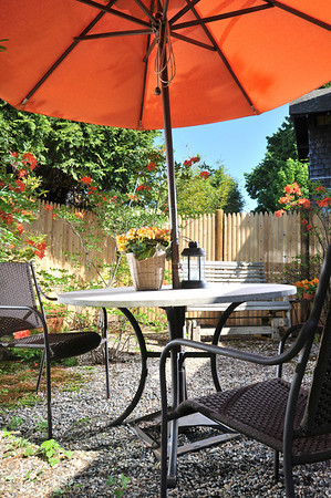 Marblehead: The patio is accented with orange flowers at the Arbor House Bed and Breakfast.   photo by Mark Teiwes / Salem News