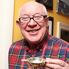 Marblehead: Noel Young holds a traditional Scottish drinking cup called a Quaich, which he received from his siblings as a birthday gift.  Photo by Liz Curtis