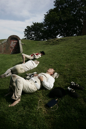 Reenactors rest on a hill at Fort Sewall after a battle against the British for the Fort as part of Glovers Regiment encampment this weekend. The event included two battles against the British along with camp tours and demonstrations. Photo by Deborah Parker/July 12, 2009