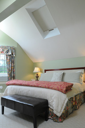 Marblehead:<br /> A bedroom with a cathedral ceiling at Harbor Light Inn.<br /> Photo by Ken Yuszkus/Salem News, Wednesday, May 19, 2010.