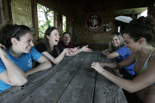 From left, good friends, Stephanie Lyons of Beverly, Meredith Bolden of Salem, Kelly Kriz of Boston, Brianna Schneider of Marblehead and Ashley Nelson of Great Barrington laugh together in the Rangers Lodge while reminiscing about their time spent on Children's Island. All five friends met while working at the island as counselors.  photo by deborah parker