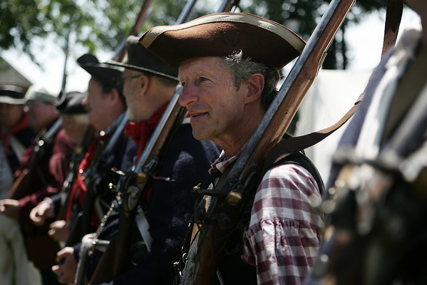 Reenactor Rich MacKay of Billerica lines up for inspection before a battle at Fort Sewall as part of Glovers Regiment encampment. The event included two battles for the Fort against the British along with camp tours and demonstrations. Photo by Deborah Parker/July 11, 2009