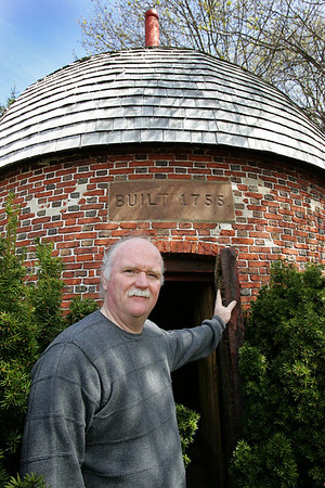 Chris Butler stands in front of the Powder House in Marblehead. Photo by Deborah Parker/April 13, 2010