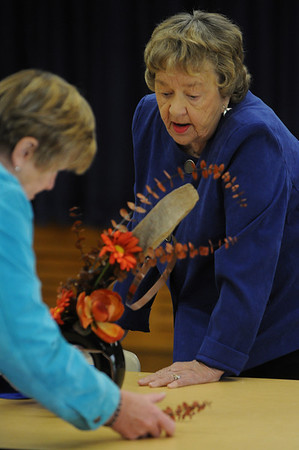 Marblehead:<br /> Nancy Donaldson, left, of Beverly, co-chair of the event, works on Ann Flynn's, right, of Marblehead, floral arrangement at the Arrangers of Marblehead meeting at The Unitarian Universalist Church of Greater Lynn.<br /> Photo by Ken Yuszkus/Salem News, Wednesday, May 12, 2010.
