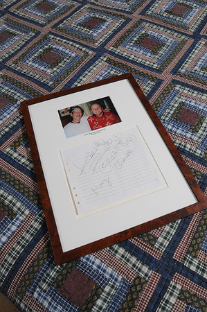 Marblehead:<br /> A photograph of Gene Arnould, owner of the Brimblecomb Hill B&B  and Keith Richards, as well as his autograph, on the bed in the Issac Mansfield room where he slept at Brimblecomb Hill B&B.<br /> Photo by Ken Yuszkus/Salem News, Tuesday, May 18, 2010.