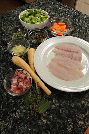 Marblehead:<br /> Barry Edelman, chef at Five Corners Kitchen in Marblehead, is cooking his dish with skatewing fish.<br /> Photo by Ken Yuszkus/Salem News, Friday, August 5, 2011.