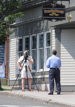 Robert Simonelli, right, introduces his show taped by Jason O'Brien outside the Three Cod Tavern for a local cable access show that features Marblehead restaurants.