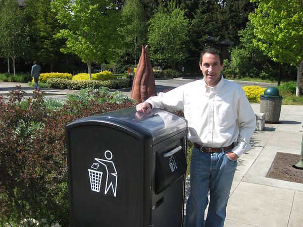 Marblehead native Jim Poss poses with the BigBelly solar-powered waste compactor.<br /> Courtesy photo.