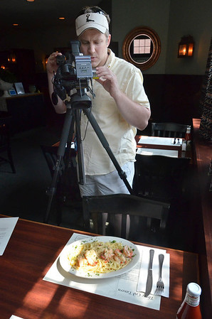 Mike Danahue, acts as producer, cameraman, and editor for the show with skills he learn at Marblehead TV, Marblehead's cable access program. He also works as a bartender and waiter at The Landing.  Here he flims a shrimp scampi dish.