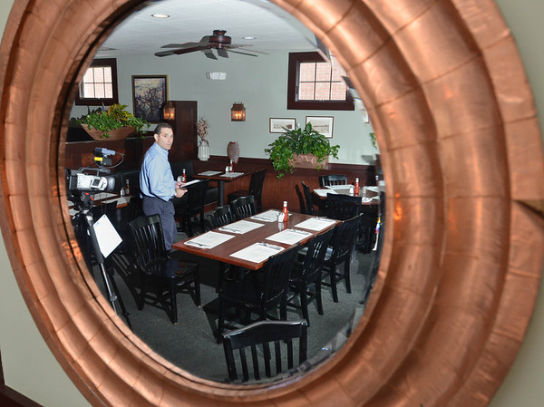 Robert Simonelli, owner of The Landing, acts as the host of a local cable access show that features Marblehead restaurants.