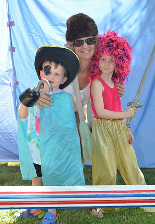 Children's Festival at the Marblehead Festival of Arts.<br /> Pictured from left: Nolan, 4, Linda, and Clara Power, 7, of Marblehead.