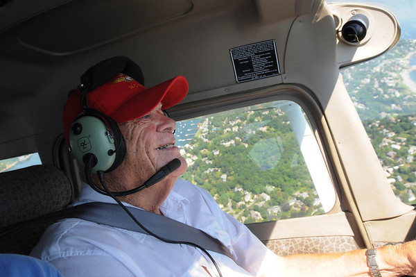 Marblehead and Beverly Airport:<br /> Don Humphreys, 87,in red hat, of Marblehead has renewed his pilot's license and is flying again after a 45-year lapse. He is flying over Marblehead with flight instructor, Dennis Silverio.<br /> Photo by Ken Yuszkus/Salem News, Tuesday, August 2, 2011.
