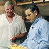 Mike Danahue, Three Cod Tavern chef, left, discusses a dish with Robert Simonelli.