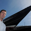Marblehead:<br /> Chris Hood, of CW Hood Yachts, with his CW Hood 32 sailboat.<br /> Photo by Ken Yuszkus/Salem News, Friday, May 6, 2011.