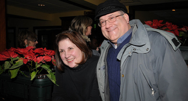 Marblehead:<br /> Donna Murphy, left, on the board of directors, and Eric Knight, vice president, both of Marblehead, attend the Marblehead Festival of Arts Logo Premiere Party held at The Landing Restaurant on Tuesday January 25.<br /> Photo by Ken Yuszkus/Salem News, Tuesday, January 25, 2011.