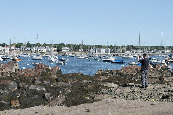 Dennis Curtin, a photographer uses his 3D camera to shoot an image of Abbot Hall on the beach at a right of way at the end of Harvard Street on Marblehead Neck.