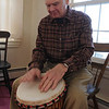 MARBLEHEAD:<br /> Playing the djembe drum is Fred Bauer, author of the new book, Marblehead's Pygmalion Finding the Real Agnes Surriage, which is about Marblehead's legend Agnes Surriage, fisherman's daughter who married rich.<br /> Photo by Ken Yuszkus/Salem News, Thursday,  December 9, 2010.