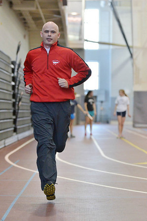 Marblehead: Mike Toomey, Marblehead High track coach, jogs at Marblehead indoor track for a picture. photo by Mark Teiwes  / Salem News