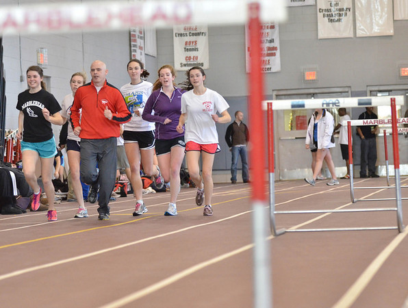 Marblehead:  Marblehead High track coach Mike Toomey, center, jogs with some the High School team for a picture.  Pictured from left, Maura Tubridy, Madeline Piela, Mike Toomey, Lillie Johnston, Courtney Maher, and Emma McGuirk.   photo by Mark Teiwes  / Salem News