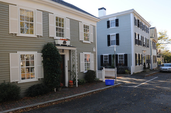 Marblehead:<br /> 18th century house built for William Sandin in 1714, left, located at 10 Washington Square.<br /> Photo by Ken Yuszkus/Salem News, Tuesday, October 25, 2011.