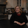 Marblehead:<br /> Pat Lausier sits in the kitchen of her house at 147 Washington Street which was built in the mid-18th century. <br /> Photo by Ken Yuszkus/Salem News, Thursday, October 27, 2011.