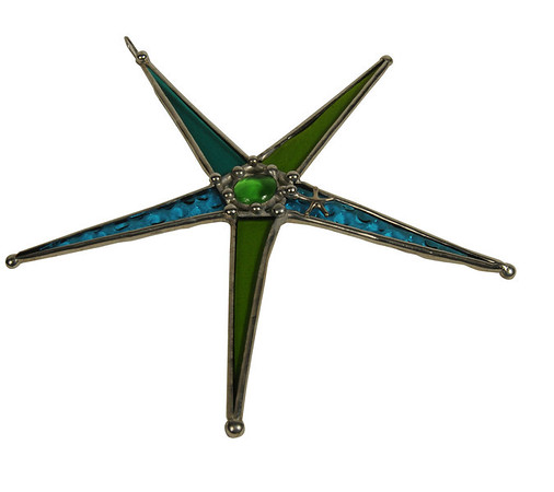 Stained glass star. Shipshape. Beverly:<br /> Various items found in Marblehead.<br /> Photo by Ken Yuszkus/Salem News, Thursday, October 6, 2011.