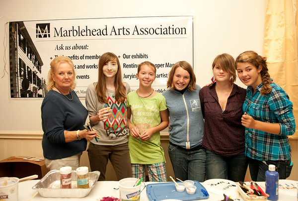 The Marblehead Arts Association set up a pumpkin painted booth during Marblehead's Fall Festival on Saturday. From left, Sue Urquhart, Lily Clark, Samantha Livermore, Maddie Miller, Kathryn Ryan, and Kyra Veprek.