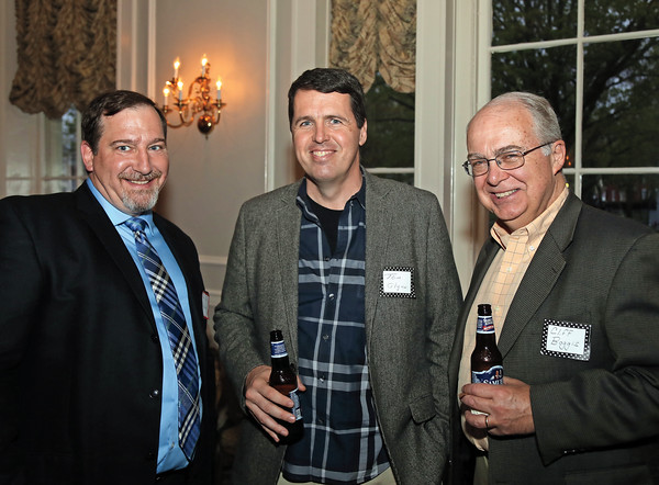 DAVID LE/Staff photo. Kevin Cullen, a past President of the MYSA, left, with Tom Glynn and Cliff Boggis, right, at the Marblehead Youth Soccer Association 40th Anniversary Gala held at the Hawthorne Hotel. 5/17/16.