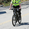 KEN YUSZKUS/Staff photo.    Marblehead police officer Mike Roads uses one of the police department's electric bikes.         05/06/16