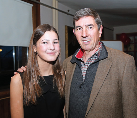 DAVID LE/Staff photo. Thirteen-year-old Elizabeth Dailey, with her father Tom, at the annual Marblehead Festival of Arts auction night held at Abbott Hall on Saturday April, 9, 2016. 4/8/16.