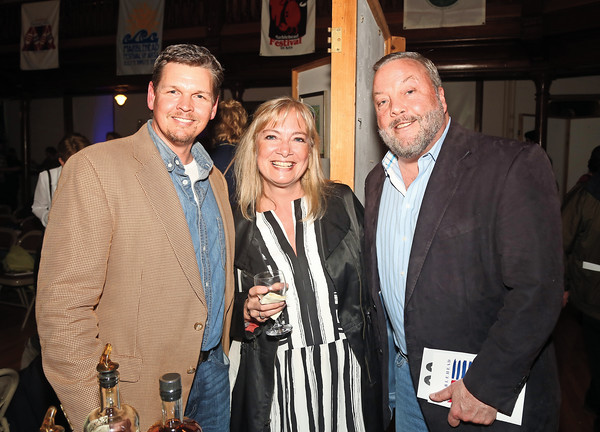 DAVID LE/Staff photo. From left, Steve Orne, of Rumsons Rum, Rebecca St. Onge, of Marblehead, and George Carey, owner of Finz Seafood and Grill and Sea Level Oyster Bar, at the annual Marblehead Festival of Arts auction night held at Abbott Hall on Saturday April, 9, 2016. 4/8/16.