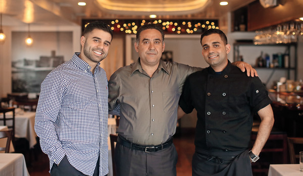 """Brothers Raffaele, left, and Luigi """"Gino"""" Scalzi, right, are co-owners of Casa Mia Cucina Italiana in Marblehead. The Scalzi brothers, with their father Alberto, center, opened Casa Mia in July 2015 and have built a reputation based on a """"fun, festive, family atmosphere."""""""