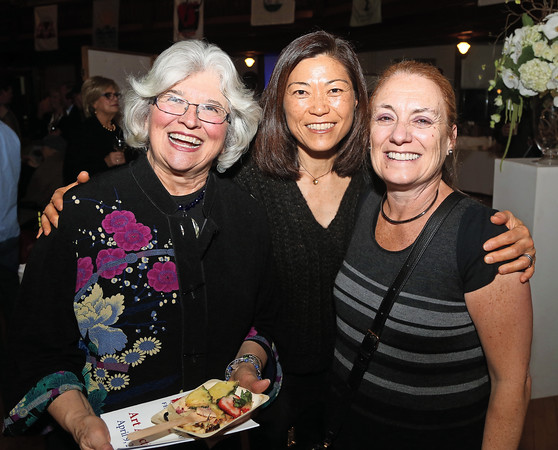 DAVID LE/Staff photo. From left, Jo Ann Silva, EuRim Chun, and Jackie Belf-Becker, all of Marblehead, at the annual Marblehead Festival of Arts auction night held at Abbott Hall on Saturday April, 9, 2016. 4/8/16.