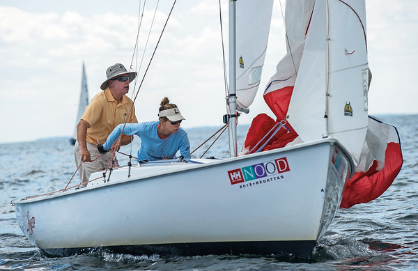 AMANDA SABGA/ Staff photo <br /> <br /> Bill and Renee Heffernan release the sail on their Rhodes 19, Sweep, during the Helly Hansen NOOD Regatta at the 126th Marblehead Race Week.<br /> 7/24/15