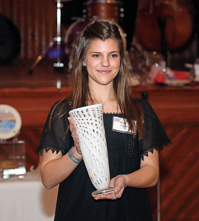 DAVID LE/Staff photo.  Volunteer Eliza Engstrom holds up a vase for auction at the annual Marblehead Festival of Arts auction night held at Abbott Hall on Saturday April, 9, 2016. 4/8/16.