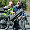 KEN YUSZKUS/Staff photo.    Marblehead police officer Mike Roads, left, and Dan Rand from the bike manufacturer talk about one of the police department's electric bikes.         05/06/16