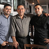 "Brothers Raffaele, left, and Luigi ""Gino"" Scalzi, are co-owners of Casa Mia Cucina Italiana in Marblehead. The Scalzi brothers, with their father Alberto, center, opened Casa Mia in July 2015 and have built a reputation based on a ""fun, festive, family atmosphere."""