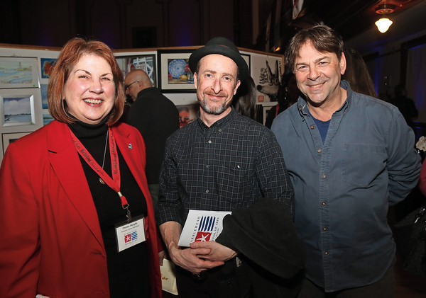 DAVID LE/Staff photo. From left, Donna Murphy, Chris Clark, and Brian Wheeler, all of Marblehead, at the annual Marblehead Festival of Arts auction night held at Abbott Hall on Saturday April, 9, 2016. 4/8/16.