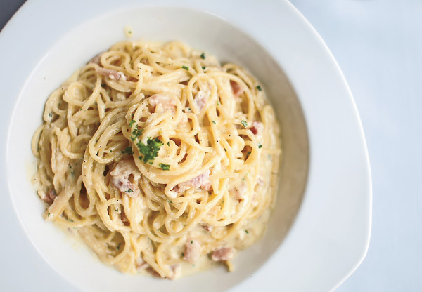 The Carbonara pasta entree from Casa Mia Cucina Italiana is made with spaghetti cooked al dente, and tossed with sautéed pancetta, parmigiano cheese, cracked black pepper and is finished with an egg yolk cream sauce.