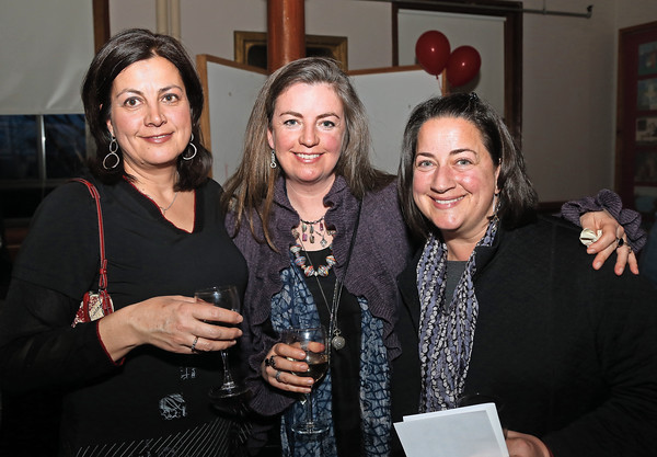 DAVID LE/Staff photo. From left, Tanya Bachelder, Susan Schrader, and Stephanie Verdun, all of Marblehead, at the annual Marblehead Festival of Arts auction night held at Abbott Hall on Saturday April, 9, 2016. 4/8/16.