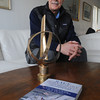 MARBLEHEAD:<br /> Rich Wilson of Marblehead, who wrote a book about a race he sailed around the world. The Vendee Globe trophy that he won for the race is in the foreground.<br /> Photo by Ken Yuszkus/The Salem News, Tuesday, February 12, 2013.