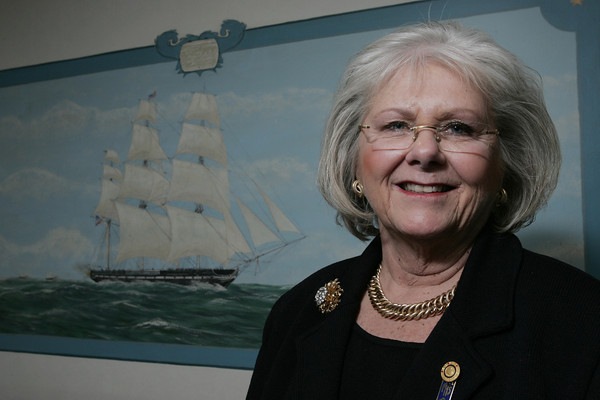 MARBLEHEAD:<br /> Marblehead Savings Bank President Julie Livingston in the boardroom with the painting of the U.S.S. Constitution behind her.<br /> Photo by Ken Yuszkus/The Salem News, Thursday, January 3, 2013.