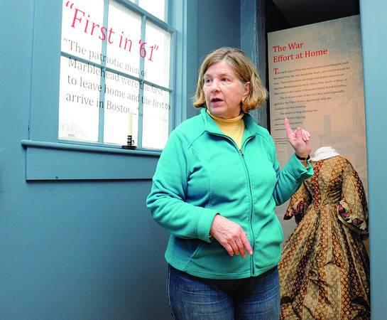 """Marblehead:<br /> Director of the Marblehead Historical Society Pam Peterson talks about the renovations on the 2nd floor of the Marblehead Old Town House. It is set to reopen after many renovations. A big celebration is planned for early December. TheOld Town House, built in 1727, is often referred to as """"Marblehead's Cradle of Liberty"""" for the many pre-revolutionary war meetings held there. It is one of the oldest town halls in America that has been in continuous use. <br />  Photo by Ken Yuszkus / The Salem News, Wednesday, November 27, 2013."""