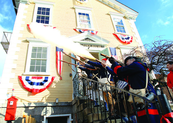 Marblehead: Members of Glover's Regiment fire off rounds during a reopening ceremony of Old Town Hall in Marblehead on Saturday morning. DAVID LE/Staff Photo