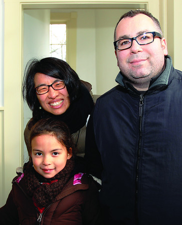 Marblehead: Teagan O'Brien, 7, with her parents Sean and Lynne O'Brien at the reopening ceremony of Old Town Hall in Marblehead. DAVID LE/Staff Photo