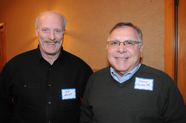 Marblehead:<br /> Bob Moses, left, and Gary Cordette, played football for Swampscott, attended the Marblehead-Swampscott annual 'Old-Timers Night' at the Gerry 5 Club in Marblehead.<br />  Photo by Ken Yuszkus / The Salem News, Monday, November 25, 2013.